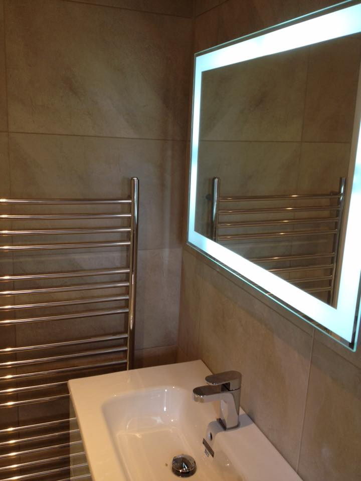 Sink, heated towel rail and lighted mirror